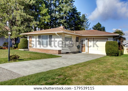 Photo of  Tile roof siding house with a garage and concrete drive way