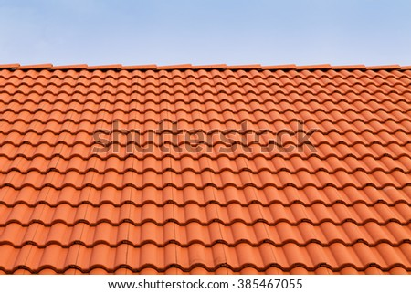 Tile roofs, patterns of blue sky #385467055