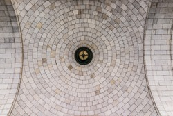 Tiled dome ceiling architecture with symmetrical details looking up
