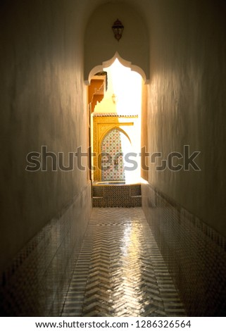 Tiled hallway and door #1286326564