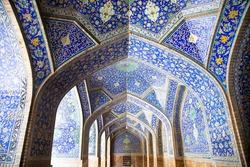 Tiled oriental arcs and pillars on Jame Abbasi mosque, Esfahan, Iran