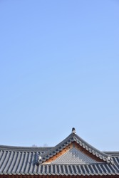 tiled roofs of Gyeongbokgung with clear sky in Seoul, Korea