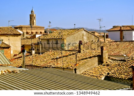 Tiled roofs of houses and the dome of the church. The color of the sand - typical for the Aragonese villages. Alcampell, Llitera, province of Huesca, Aragon, Spain