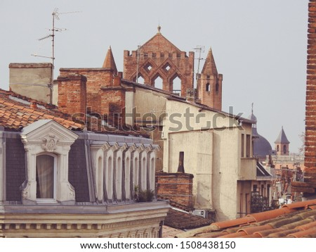 Tiled rooftops and citytop of Toulouse with the famous traditional orange brick architecture of the city. Panoramic view of the capital of southern France Occitanie region against sky background #1508438150