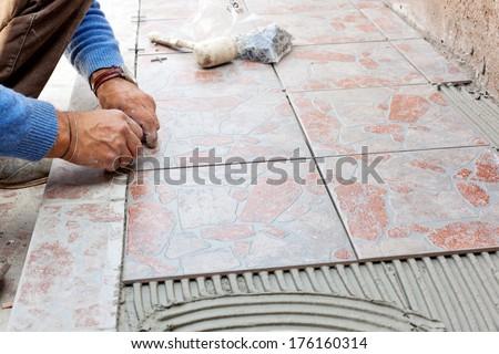 Tiler to work with tile flooring for garden