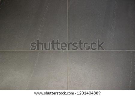 Tiles grey wall. Tiles grey floor. Grey background.