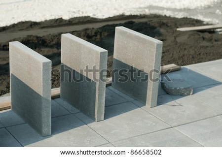 Tiling of pavement and sand pile. Three tiles