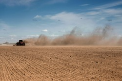 Tillage in a strong wind. Soil erosion. Ecological problems.