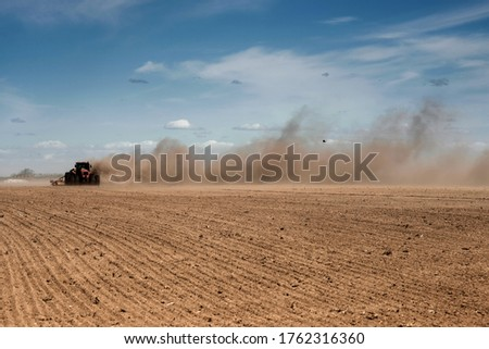 Tillage in a strong wind. Soil erosion. Ecological problems. Photo stock ©