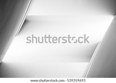 Tilt close-up photo of plastered walls in backlight. Abstract black and white background on the subject of architecture, industry or technology with spacious area for text placement. #539359693