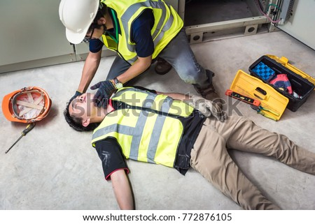 Tilt Head, Life-saving and rescue methods. Accident at work of electrician job or Maintenance worker in the control room of factory.