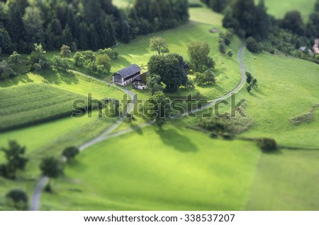 Tilt Shift Aerial View of Agricultural Fields - stock photo
