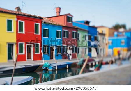 Tilt shift photo in street of Burano island. Soft focus