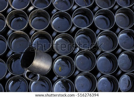Tilted Black Ceramic Mug breaking the Abstract repetition pattern #516276394