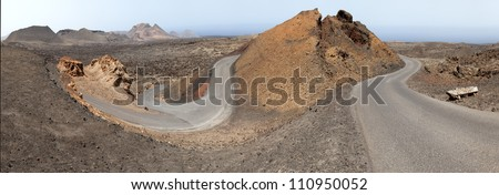 Timanfaya National Park, Road in volcanic stone desert on Lanzarote, Canary islands, Spain