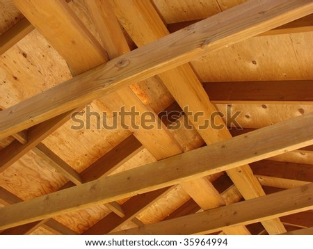 Timber beam construction looking up into roof