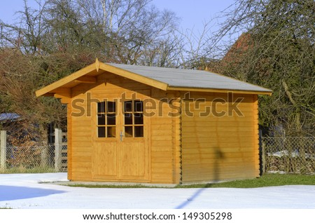 Timbered garden shed in snow