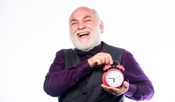 Time and age concept. Bearded man clock ticking. Aged man holding alarm clock. Lifetime ageing and getting older. Senior man white beard. Senior timekeeper. Counting time. Time does not spare anyone.