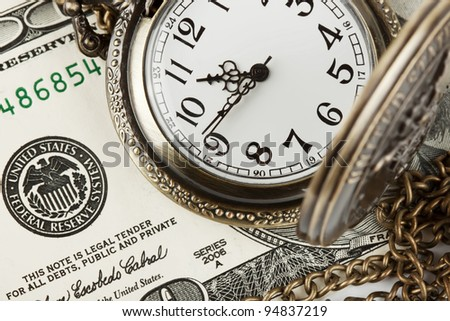 Time and money concept image. Pocket watch and US currency