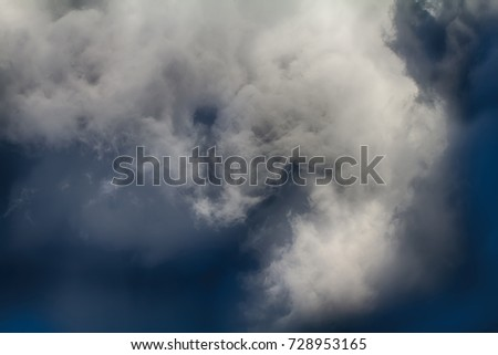 Time before storm. Turbulence of atmosphere (atmospheric perturbations) before thunderstorm, prethunderstorm sky. Wonderful clouds against warm sky, ragged clouds. Rare phenomenon of weather