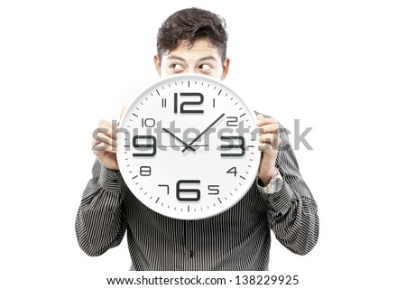 Time concept,Businessman holding big clock and give the expression on his face