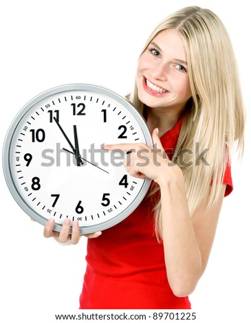 time concept. five to twelve. young beautiful woman holding big clock