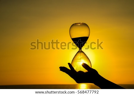 Time Concept Hourglass and Sun Setting on the Atlantic Ocean Stock photo ©