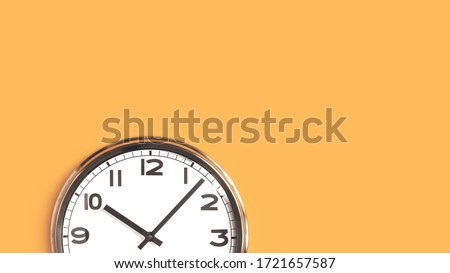 Time concept. Top part of white wall clock face on pastel saffron orange background flat lay. Close up copy space, time management or opening hours. Summer or winter daylight saving time change banner
