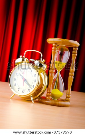 Time concept with clock and hour glass - stock photo