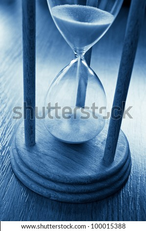 time concept with hourglass blue toned image
