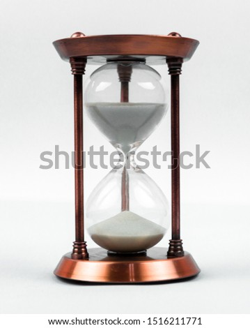 time concept with hourglass lying toned in warm black and white, retro style, vertical orientation. #1516211771