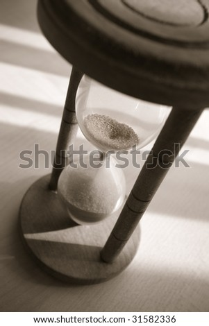 time concept with old hourglass in warm black and white
