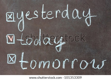 Time concept: words today, yesterday, tomorrow written on a blackboard