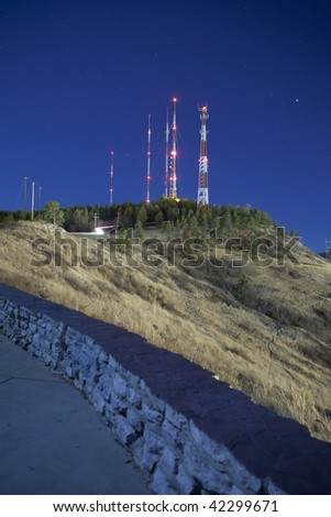 time exposure of radio towers on mountain at night - stock photo