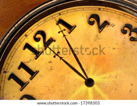 time flies - clock with hands just past midnight - minute hand in motion - grunge