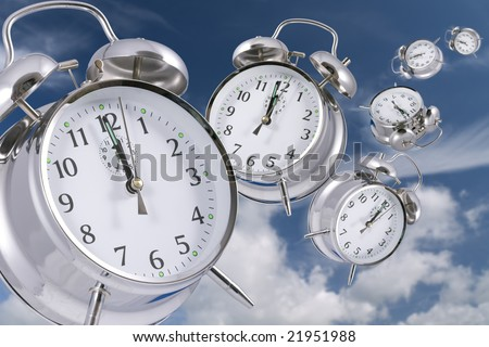 Time flies concept - alarm clocks disappearing into the distance