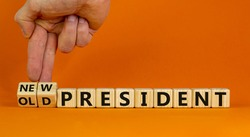 Time for a new president. Male hand turns cubes and changes the words 'old president' to 'new president'. Beautiful orange background. Copy space. Concept.