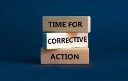 Time for corrective action symbol. Wooden blocks with words 'Time for corrective action' on a beautiful grey background. Business, time for corrective action concept. Copy space.