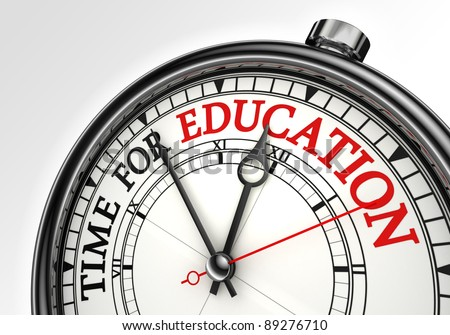 time for education concept clock closeup on white background with red and black words