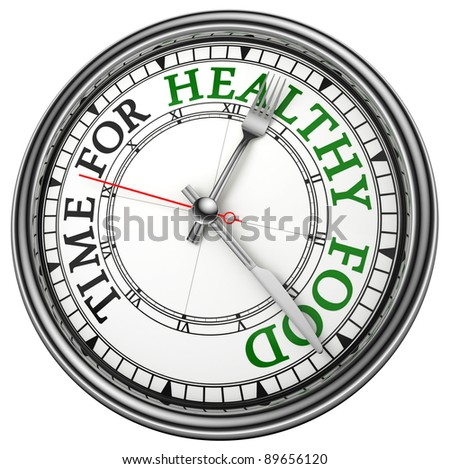 time for healthy food concept clock closeup on white background with red and black words
