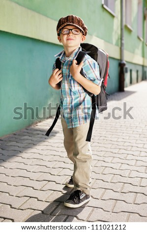 Time for school. Dreamy kid.
