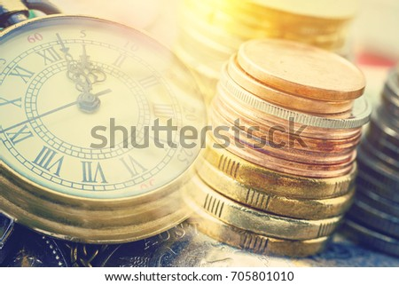 Time is money, business finance concept : Many coins and vintage brass pocket watch, idea of time which is a valuable commodity or resource and it's better to do work or things as quickly as possible. #705801010
