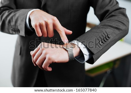 Time is money. Businessman pointing on watch. Business concept