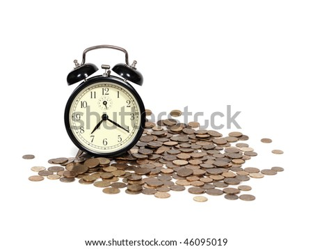 TIME IS MONEY concept: alarm clock and lots of golden coins