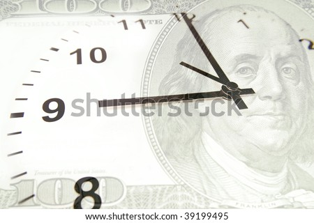 Time is money financial concept. Clock on U.S. hundred dollars.