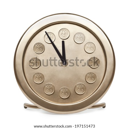 Time is money. Large gold table clock with Russian coins on the dial.