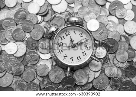 Time is money . Watch and coins . Vintage retro alarm clock lie on metal american cent coins. Business, finance background. empty copy space for inscription or objects. #630393902