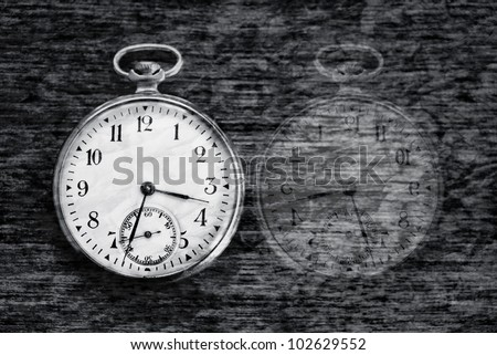 time pass vintage conceptual image; textured old clock