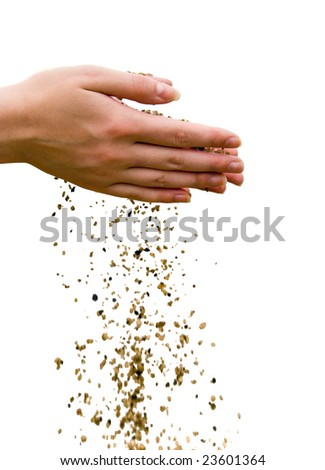Time passing concept. Falling out sand from human hands. Isolated