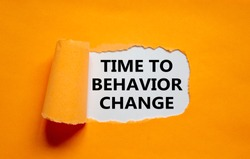 Time to behavior change symbol. The text 'Time to behavior change' appearing behind torn orange paper. Business, growth and time to behavior change concept. Copy space.